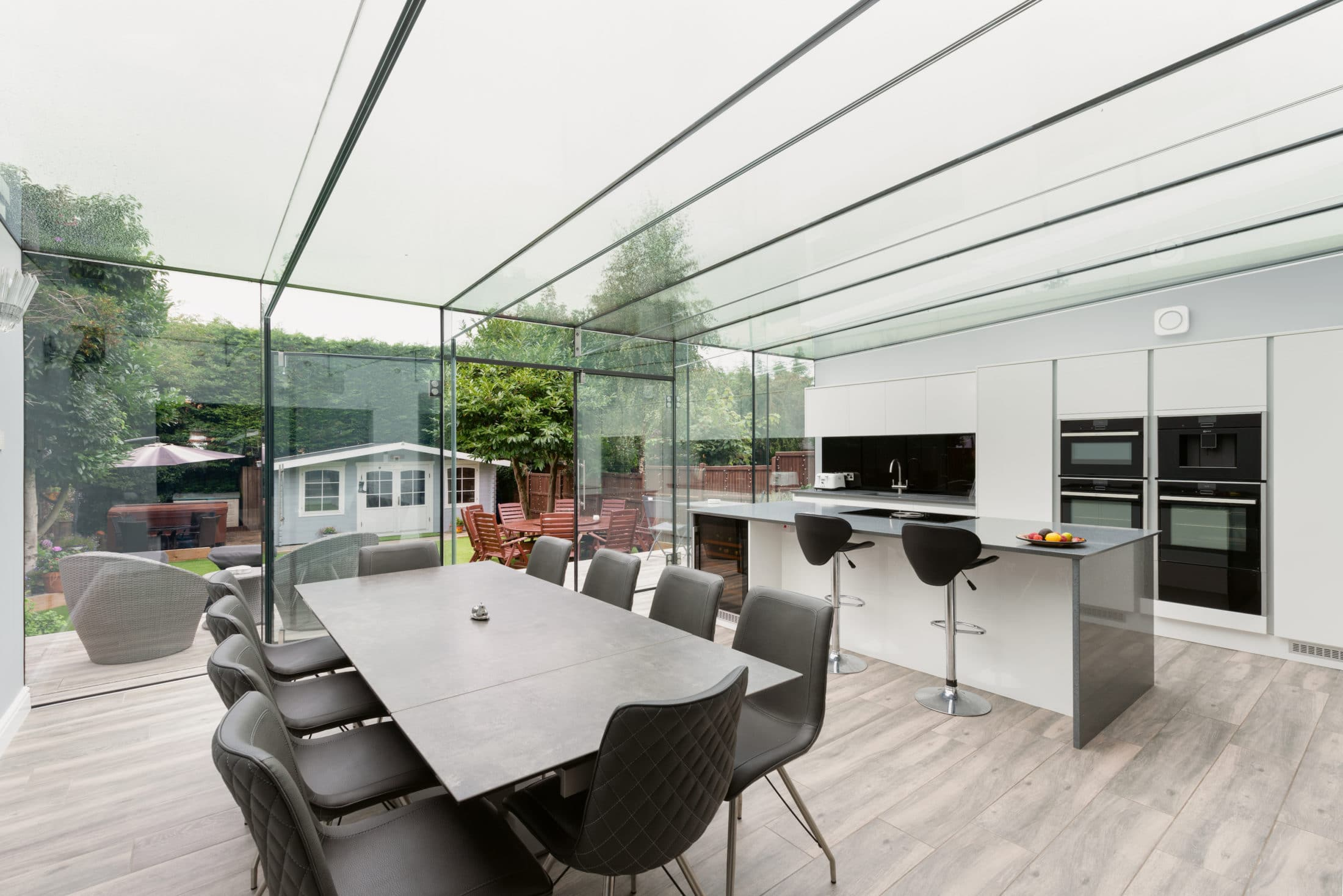 Glazed kitchen extension and family hub